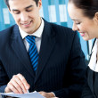 Two happy businesspeople working together at office — Stock Photo #8776014