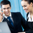 Two happy businesspeople working together at office — Stock Photo