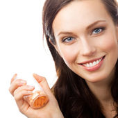 Woman showing bottle with pills, isolated — Stock Photo
