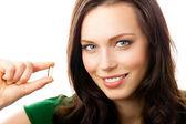 Vrouw met omega-3 vissen olie capsule, op wit — Stockfoto