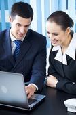 Two businesspeople working with laptop at office — Stock Photo