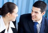 Two happy businesspeople at office — Stock Photo