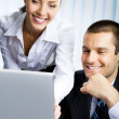 Foto Stock: Two business working with laptop