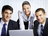 Businesspeople working with laptop at office — Stock Photo