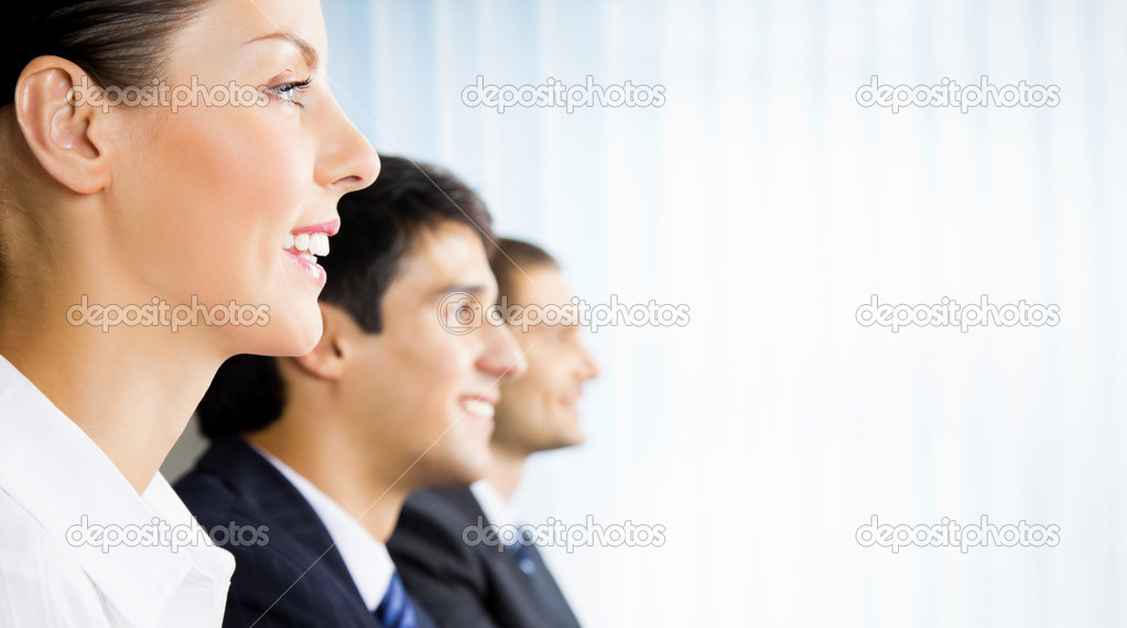 Three young happy smiling successful businesspeople at meeting, presentation or conference, with copyspace — Stock Photo #8877987