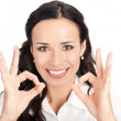 Businesswoman with okay gesture, on white - Foto Stock