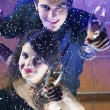 Couple at celebration with glasses of champagne — Stok fotoğraf