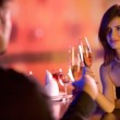 Couple with glasses of champagne on date — Stock Photo