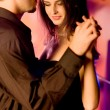 Young couple dancing — Stock fotografie #9615504