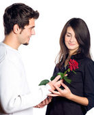 Young couple with rose, isolated — Stock Photo