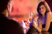 Couple with glasses of champagne on date — ストック写真