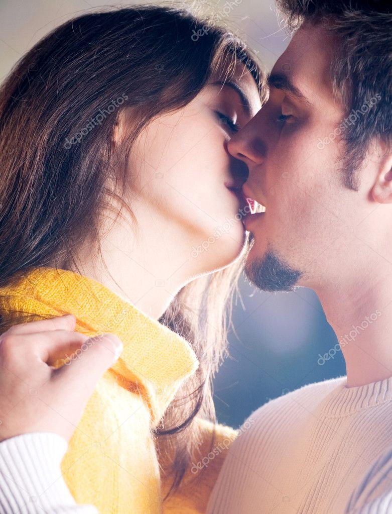 Young happy couple kissing outdoors — Stock Photo #9615430