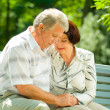 Senior couple in headset together, outdoors — Stock Photo