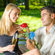 Couple with glasses of champagne and rose, outdoors — Stock Photo #9706672