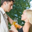 Young happy couple with champagne, outdoor — Stock Photo #9706684