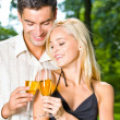 Young happy couple with champagne, outdoor — Stock Photo #9706689