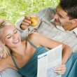 Young cheerful couple reading, outdoors — Stockfoto #9706709