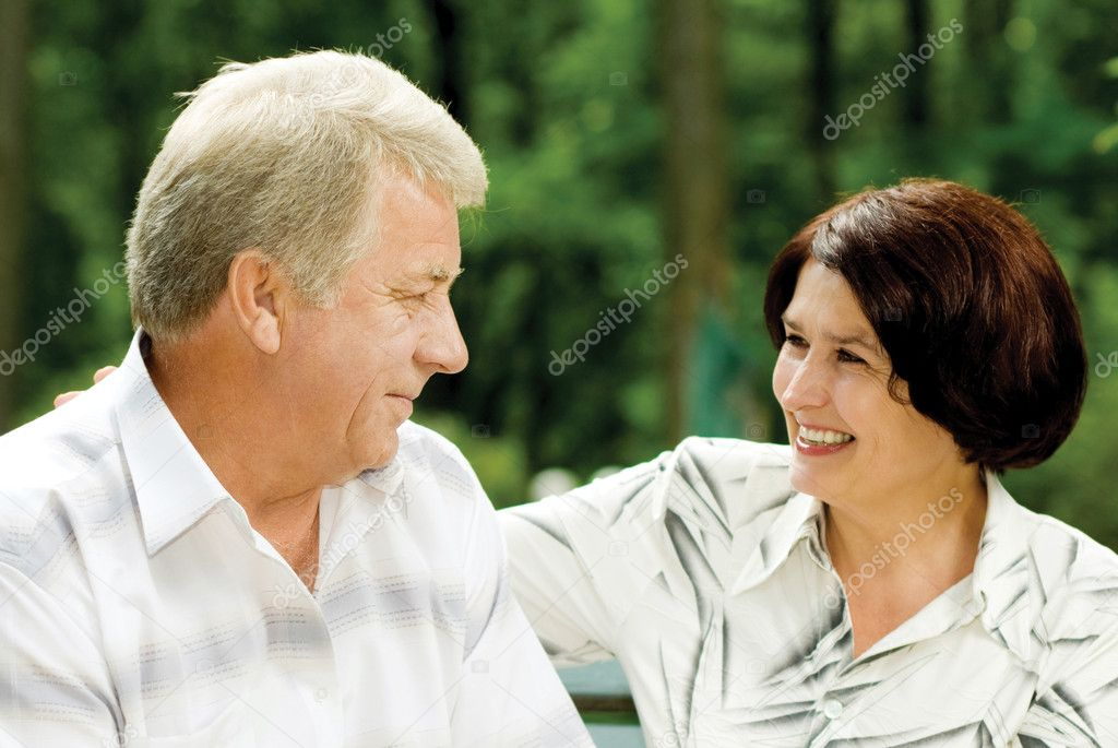 Portrait of attractive senior happy smiling cheerful couple embracing, outdoors  Stock Photo #9701141