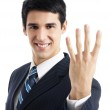 Businessman showing four fingers, isolated — Stock Photo