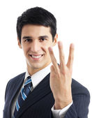 Businessman showing three fingers, isolated — Stock Photo