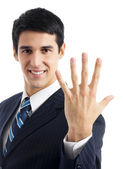 Businessman showing five fingers, isolated — Stock Photo