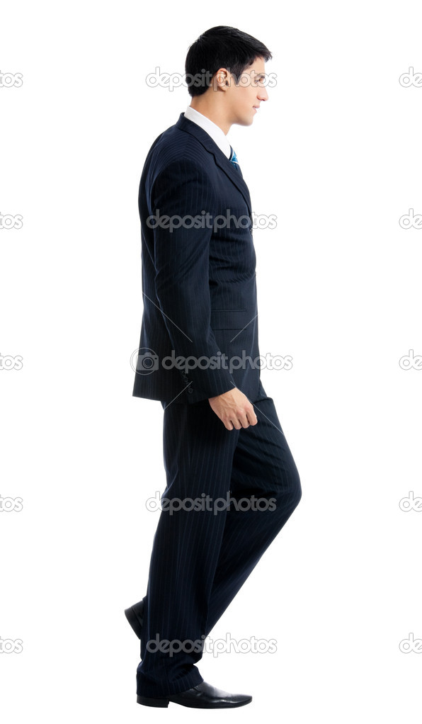 Full body portrait of walking young business man, isolated over white background — Stock Photo #9710730