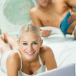 Young couple working with laptop — Stock Photo
