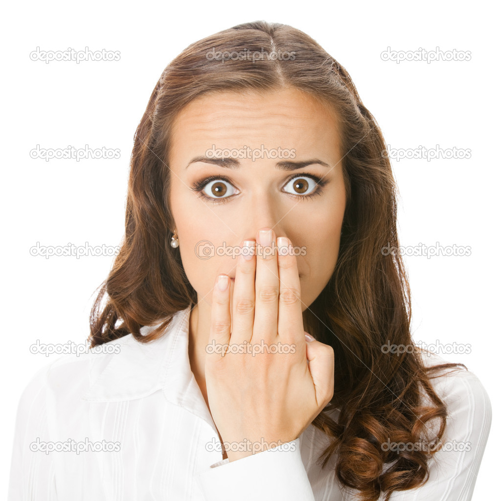 Portrait of happy smiling young business woman covering with hand her mouth, isolated over white background  Stock Photo #9818967