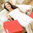 Young happy woman with shopping bags — Stock Photo #9830691