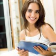Woman reading magazine at home — Stock Photo #9830794