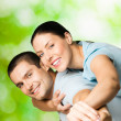 Portrait of young smiling couple, outdoors — Stock Photo #9965944