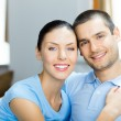 Young happy couple at home — Stock Photo