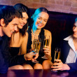Young happy with champagne at party — Stock Photo