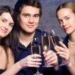 Stock Photo: Young happy with champagne at party