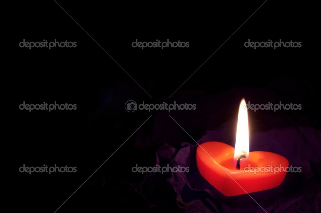 Coloured candle shaped heart on black backcloth — Stock Photo #8334548