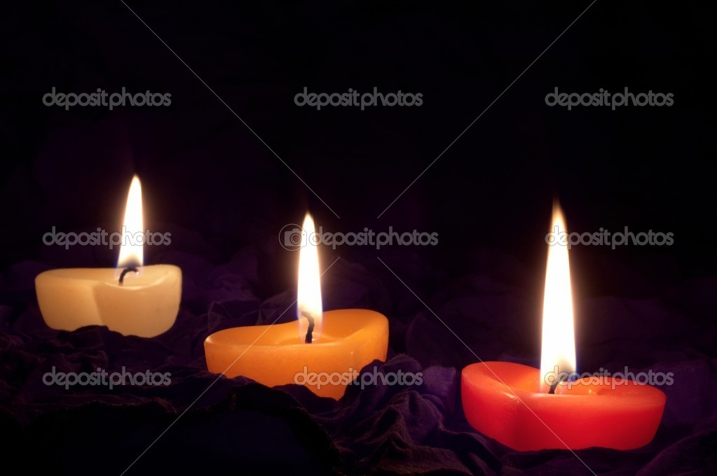 Coloured candle shaped heart on black backcloth — Stock Photo #8334569