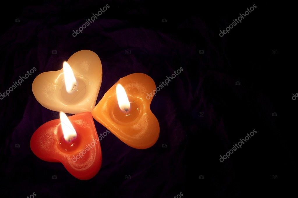 Coloured candle shaped heart on black backcloth — Stock Photo #8334579