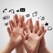 Happy group of finger smileys with social chat sign and speech bubbles. — Stock Photo