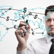 Young business man drawing a global network with Dollar Signs on world map. — Stock Photo