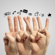 Happy group of finger smileys with social chat sign and speech bubbles. — Stock Photo #10105580