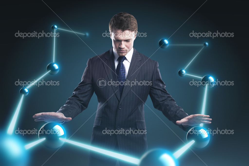Man is controlling the earth models. Young business man with planet system around him. Conceptual image of technology global communication — Stock Photo #7995644