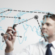 Stock Photo: Young business man drawing a global network or globalization concept