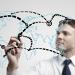 Young business man drawing a global network or globalization concept — Stock Photo