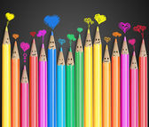 Group of coloured smiling pencils with love heart speech bubbles — Stock Photo