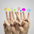 Happy group of finger smileys with social chat sign and speech bubbles — Stock Photo #8267233