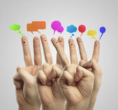 Happy group of finger smileys with social chat sign and speech bubbles — Foto Stock