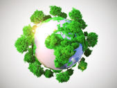 Model of Earth with oversized trees. — Stock Photo