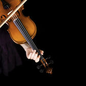 Young girl practicing the violin. Over black background. — Stock Photo