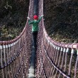 Stock Photo: Boy on swing bridge