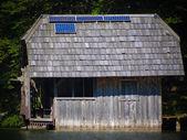 Fishing lodge with Solar array — Stock Photo